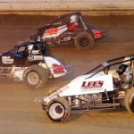 Dustin Smith (37), Aaron Middaugh (91) and Andre Layfield slug it out for position during the BOSS wingless sprint-car feature at Pittsburgh's Pennsylvania Motor Speedway. (Hein Brothers Photo)