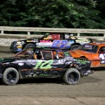 Hobby-stock drivers battle three-wide during Saturday's event at Bubba Raceway Park in Ocala, Fla. (R.E. Wing Photo)