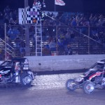 Kyle Larson (71) just beats Brad Sweet across the finish line to win the USAC Mopar National Midget Series Gold Crown Midget Nationals at Tri-City Speedway. (Don Figler Photo)