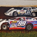 Jonathan Davenport (15) and Donnie Moran battle for position during World of Outlaws Late Model Series competition at The Dirt Track at Charlotte. (Justin Leedy photo)