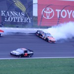 Marcos Ambrose (9) and Trevor Bayne (21) hit the wall during the Hollywood Casino 400 Sunday at Kansas Speedway. (Don Figler Photo)