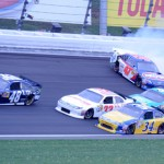Bobby Labonte (47) spins as the field attempts to miss him during Sunday's Hollywood Casino 400 at Kansas Speedway. (Don Figler Photo)