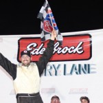Allen Purkhiser celebrates in Rev-Oil Pro Cup Series victory lane Saturday at Hickory (N.C.) Motor Speedway. (Adam Fenwick/AKFPhotos.com Photo)