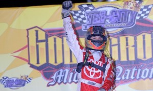 Kyle Larson celebrates winning the Gold Crown Nationals at Tri-City Speedway October. (Don Figler photo)