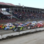 Super DIRTcar Series drivers go four-wide to salute the fans at Orange County Fair Speedway Sunday. (Dick Ayers Photo)