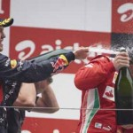 Sebastian Vettel (left) celebrates on the Formula One podium alongside Fernando Alonso after the Indian Grand Prix Sunday. (Steve Etherington Photo)