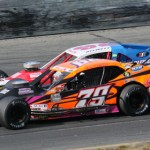Woody Pitkat (79) and polesitter Jimmy Blewett battle during Sunday's NASCAR Whelen Modified Tour feature at Stafford Motor Speedway. (Dick Ayers Photo)