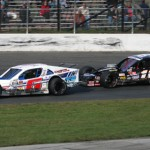 Ron Silk (6) and Ryan Preece battle during Sunday's NASCAR Whelen Modified Tour feature. (Dick Ayers Photo)