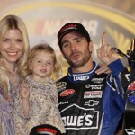 Jimmie Johnson celebrates with his wife and daughter in victory lane at Texas Motor Speedway. (HHP/Harold Hinson Photo)