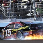 Clint Bowyer's No. 15 Toyota catches fire after a late-race tangle with Jeff Gordon Sunday at Phoenix Int'l Raceway. (HHP/Harold Hinson Photo)