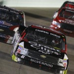 James Buescher leads a pack of cars during the Ford EcoBoost 200 Friday at Homestead-Miami Speedway. (HHP/Brian Lawdermilk Photo)