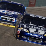Jimmie Johnson (48) and Brad Keselowski battle during Sunday's NASCAR Sprint Cup Series finale at Homestead-Miami Speedway. (HHP/Brian Lawdermilk Photo)