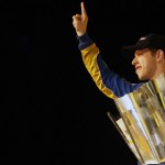 Brad Keselowski poses with the 2012 NASCAR Sprint Cup Series championship trophy after claiming the title Sunday night. (HHP/Brian Lawdermilk Photo)
