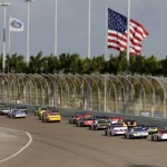 The NASCAR Sprint Cup Series field flows down the backstretch at Homestead-Miami Speedway on Sunday. (HHP/Harold Hinson Photo)