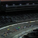 The NASCAR Sprint Cup Series field flies through a turn late in the AAA Texas 500 at Texas Motor Speedway. (NASCAR Photo)