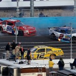 Cole Whitt (88) and Elliott Sadler (2) crash in turns three and four as Sam Hornish Jr. passes beneath them during the NASCAR Nationwide Series race at Phoenix Int'l Raceway. (NASCAR Photo)