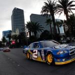 2012 NASCAR Sprint Cup Series champion Brad Keselowski (2) drives through Las Vegas during the NASCAR Victory Lap on the Las Vegas Strip Thursday. (NASCAR Photo)