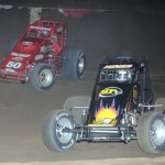Tracy Hines (4) and Mike Spencer battle for the lead during the Budweiser Oval Nationals at Perris (Calif.) Auto Speedway Saturday night. (Marv Keller Photo)