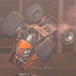 Thomas Meseraull goes end over end during the USAC Budweiser Oval Nationals Saturday night at Perris (Calif.) Auto Speedway. (Marv Keller Photo)