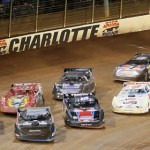 World of Outlaws Late Model Series drivers slide through turn fourat The Dirt Track at Charlotte Motor Speedway. (Dave Dalesandro/DSI Photo)