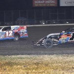 Jason Hughes (12) tries to stop Jeremy Payne from putting him a lap down during Saturday's United States Modified Touring Series finale at Royal Purple Raceway in Texas. (RonSkinnerPhotos.com Photo)