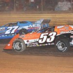 Ray Cook (53) moves under Dennis Franklin to take the lead during the Turkey 100 at Swainsboro (Ga.) Raceway on Saturday. (RonSkinnerPhotos.com Photo)