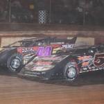 Mike Marlar (5b) battles under Tim Lance at Swainsboro (Ga.) Raceway on Saturday night. (RonSkinnerPhotos.com Photo)