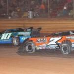 Jason Fitzgerald (7) battles Chris Wilson at Swainsboro (Ga.) Raceway Saturday night. (RonSkinnerPhotos.com Photo)