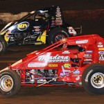 Mike Spencer (50) looks low alongside Tracy Hines during the Budweiser Oval Nationals Saturday night at Perris (Calif.) Auto Speedway. (Doug Allen Photo)