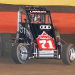 Kyle Larson slides through a corner en route to victory in the USAC Turkey Night Grand Prix at Perris (Calif.) Auto Speedway. (Doug Allen Photo)