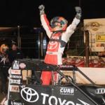 Kyle Larson celebrates after winning the 2012 running of the Turkey Night Grand Prix at Perris (Calif.) Auto Speedway. (Doug Allen Photo)