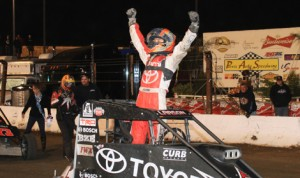 Kyle Larson celebrates after winning the 2012 running of the Turkey Night Grand Prix at Perris (Calif.) Auto Speedway. (Doug Allen Photo)