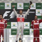 Jenson Button (center) celebrates his third Formula One victory of the 2012 season Sunday in Sao Paulo, Brazil. (Steve Etherington Photo)
