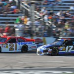 Trevor Bayne (21) and Matt Kenseth battle for position early in the AAA Texas 500. (Owen & Lynne Richards Photo)