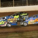 Peter Britten (21a), Brett Hearn (20) and Matt Sheppard battle during Super DIRTcar Series action at The Dirt Track at Charlotte Motor Speedway. (Dick Ayers Photo)