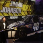 Jimmie Johnson takes the stage during the 2012 NASCAR Sprint Cup Series banquet in Las Vegas. (HHP/Harold Hinson Photo)