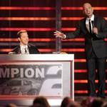 NASCAR Sprint Cup Series Banquet Host Howie Mandel talks as Brad Keselowski and Roger Penske look on Friday in Las Vegas. (NASCAR Photo)
