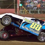 An open-wheel modified catches some air during action at East Bay Raceway Park on Saturday evening. (Robert Wing Photo)