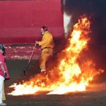 East Bay Raceway Park safety officials light spilled gas on fire in order to clean the track Saturday in Florida. (Robert Wing Photo)