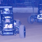 Tony Stewart (14) holds off Bryan Clauson en route to victory during the Lucas Oil POWRi National Midget Series Battle at the Center Saturday in DuQuoin, Ill. (Don Figler Photo)