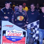 Tony Stewart and his crew pose in victory lane after winning the Lucas Oil POWRi National Midget Series Battle at the Center Saturday in DuQuoin, Ill. (Don Figler Photo)
