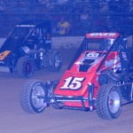 Tim Siner (15) and Jon Stanbrough battle during the Lucas Oil POWRi National Midget Series Battle at the Center Saturday in DuQuoin, Ill. (Don Figler Photo)