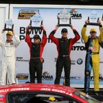 The top-three finishers in the Continental Tire Sports Car Challenge Series Grand Sport class celebrate on the podium Friday at Daytona Int'l Speedway. (Grand-Am Photo)