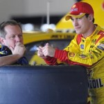 Joey Logano (right) talks with crew chief Todd Gordon during a break in testing at Daytona Int'l Speedway Saturday. (NASCAR Photo)