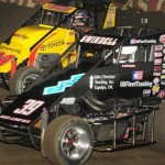 Kevin Swindell (39) and Tracy Hines race together during the 2013 Chili Bowl in Tulsa, Okla. (Frank Smith Photo)
