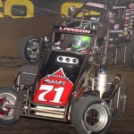 Kyle Larson (71) tries to hold off Kevin Swindell midway through Saturday's Chili Bowl finale in Tulsa, Okla. (Frank Smith Photo)