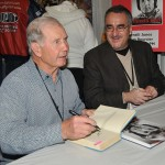 Featured guest Parnelli Jones (left) was on hand to autograph his new book along with the author Bones Bourcier at the Motorsports Show 2013. (Harry Cella Photo)