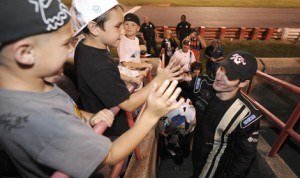 Corey LaJoie greets fans at Bowman Gray Stadium in Winston-Salem, N.C., after winning his first NASCAR K&N Pro Series East race in 2012. Lajoie makes his Camping World Truck Series debut on Thursday. (NASCAR Photo)