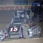 Chad Boat (15x) holds off Dave Darland during preliminary action as part of the 2013 Chili Bowl Midget Nationals in Tulsa, Okla. (Ken Simon Photo)