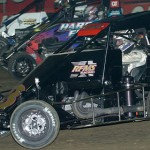 Darren Hagen (3) tries to move below a pair of cars during B Main action as part of the 2013 Chili Bowl finale in Tulsa, Okla. (Keenan Wright Photo)